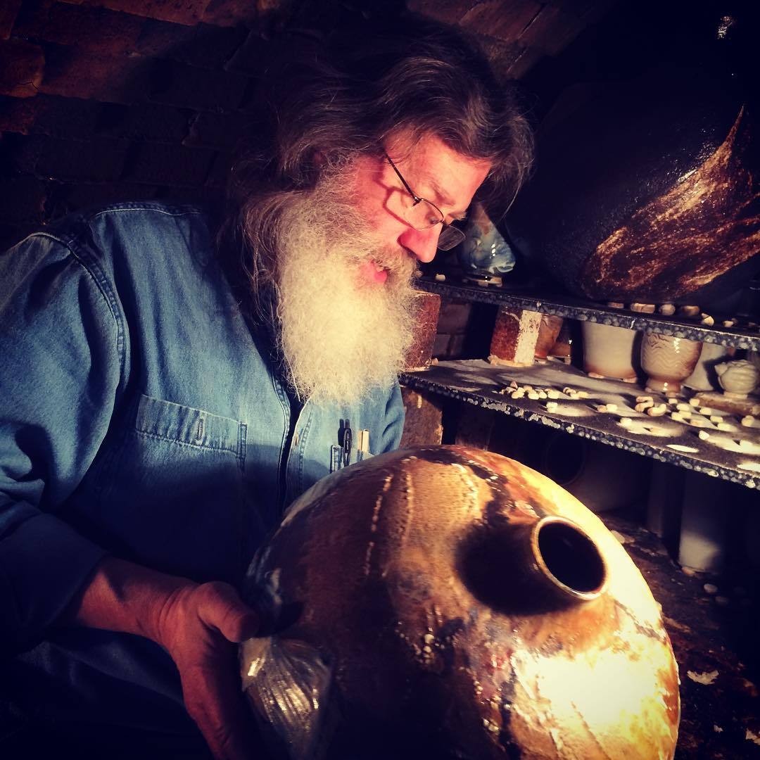Gordon Hutchens in his kiln. The kiln here is still very warm as we unload. He meticulously examines and caresses each piece as he pulls irbid the shelf, still warm. This is one of his large vessels. So lucky to be firing with him.