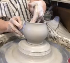 cori sandler pulling wall of a mug